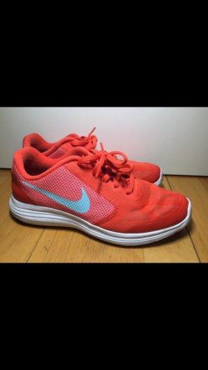 Nike Sneaker stringata salmone-arancio neon
