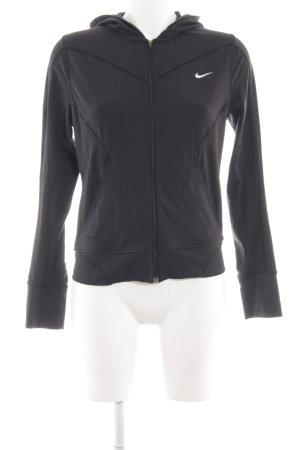 Nike Sportjacke schwarz-weiß abstraktes Muster sportlicher Stil