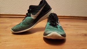 Nike Sportschuhe schwarz /türkis