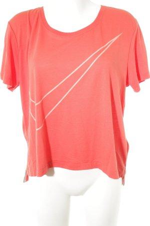 Nike Sportshirt hellrot-apricot Monogram-Muster sportlicher Stil