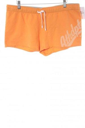Nike Sportshorts orange Schriftzug gedruckt sportlicher Stil