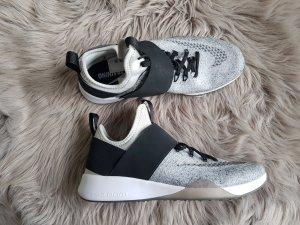 Nike Sneaker con strappi nero-argento Nylon
