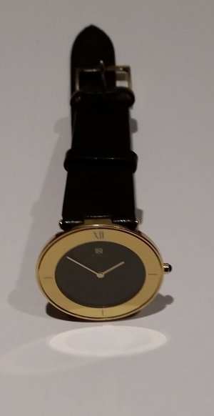 Watch With Leather Strap black-gold-colored stainless steel