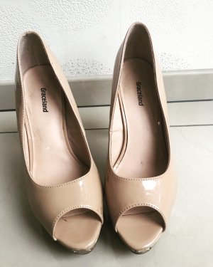 Nude Peeptoe Pumps