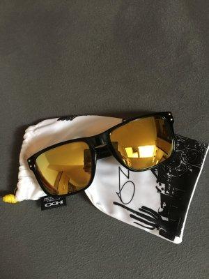 Oakley Ovale zonnebril zwart-goud