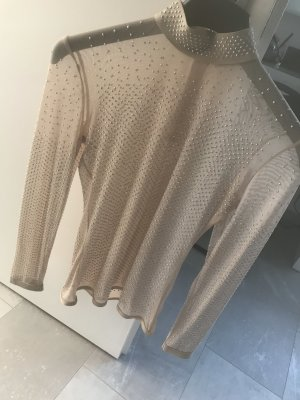 Cuello de blusa beige