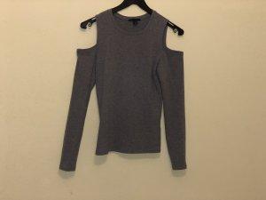 Camisa de un solo hombro color plata