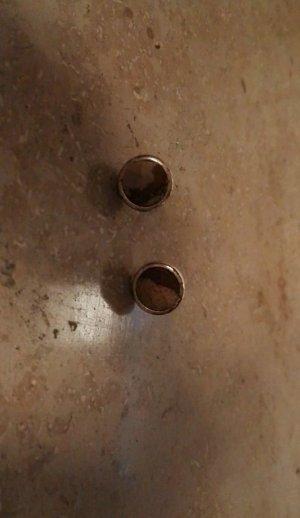 Zilveren oorbellen brons