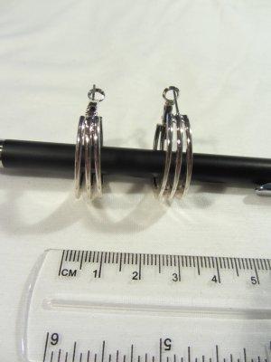 Ohrringe: Creolen, dreichfach, in Silber (Modeschmuck)
