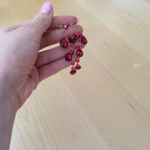 Oorstekers baksteenrood-rood