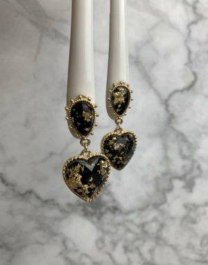 Ear stud black-gold-colored