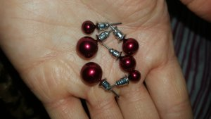 Ear stud dark red