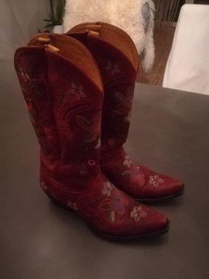 Botas estilo vaquero carmín Cuero