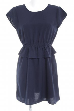 Only Vestido peplum azul oscuro look casual