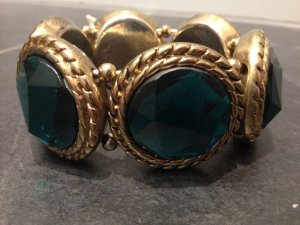 Opulentes Armband in Gold und Smaragdgrün