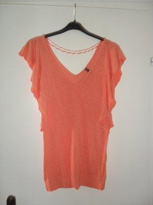 Orangefarbendes, längeres, leicht durchsichtiges Oberteil