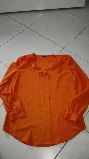 Orangefarbene Langarmbluse