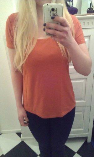 orangefarbenes T-Shirt von Comma