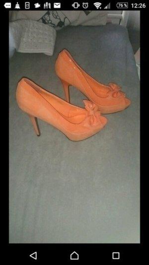 Orangene Lack highheels mit Schleife