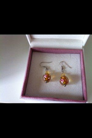 orangene Ohrringe mit Blumen