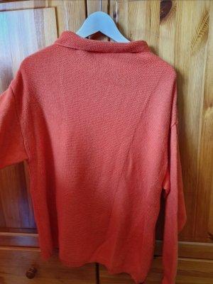 Orangener Reiss Pullover
