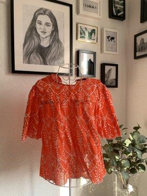 Orangenes Shirt