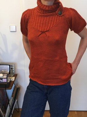Oranger Kurzarmpulli aus Wolle mit Rollkragen