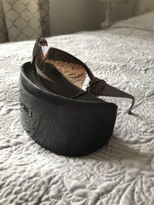 Chanel Gafas de sol ovaladas marrón grisáceo