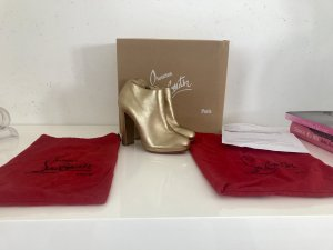 Original Christian Louboutin Gr. 36,5 gold