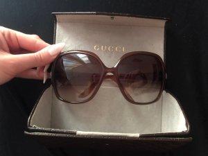 Gucci Occhiale da sole rotondo marrone-grigio
