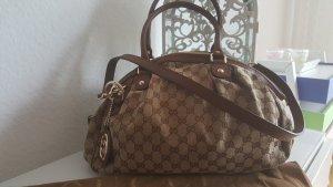 Gucci Bandolera color bronce-marrón grisáceo