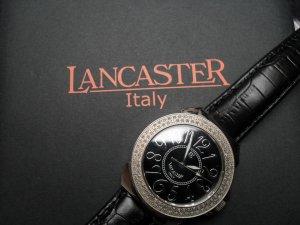 Reloj con pulsera de cuero negro-color plata acero inoxidable