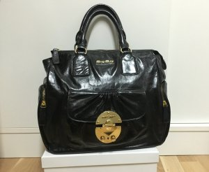 Miu Miu Bolso negro-color oro