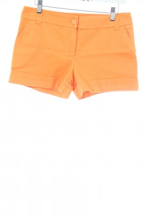 Orsay Shorts naranja claro look casual