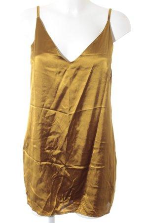 Blouse oversized doré style festif