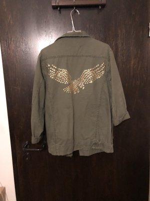Oversized Jacke mit goldenen Nieten am Rücken
