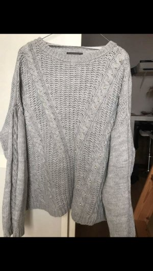 Oversized pullover mit Perle