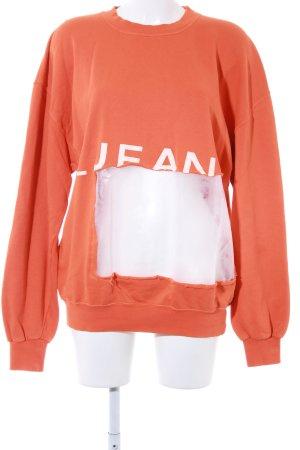 Oversized Pullover orange-weiß Schriftzug gedruckt Street-Fashion-Look
