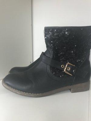 Hoge laarzen zwart-goud