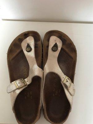 Papillio Sandalo toe-post oro