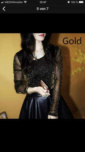 Blusa brillante negro-color oro