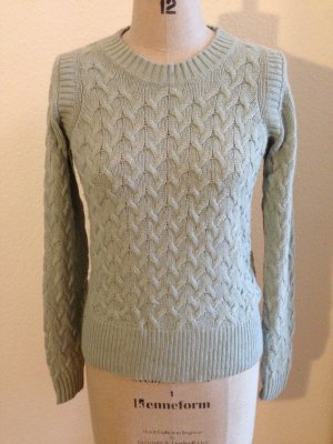 Pastell farbener Wollpullover mit Zopfmuster