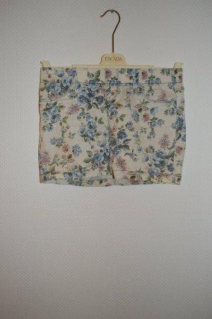 Pastellfarbener Minirock mit Blumenmuster