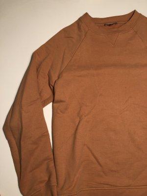 Peachfarbener COS Pullover
