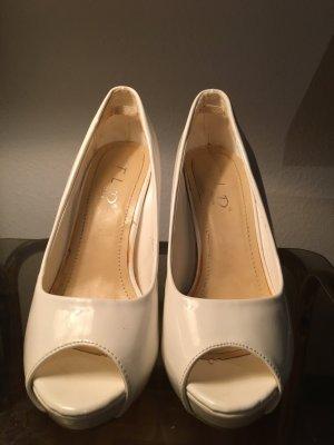 Peep Toe heels in white