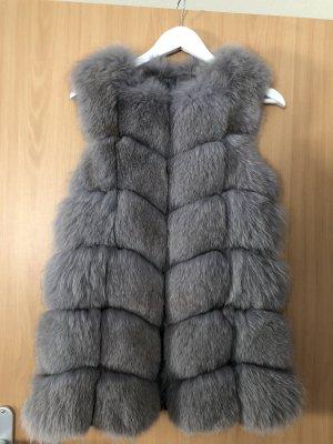 Chaleco de piel color plata-gris