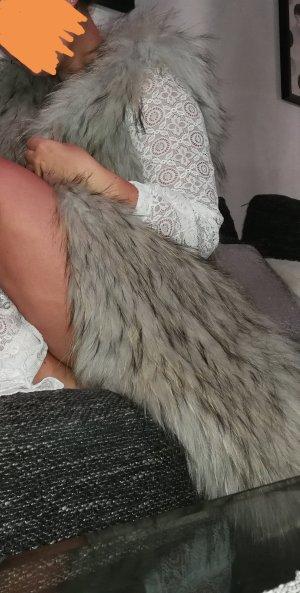 Veste de fourrure gris clair pelage