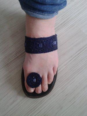 Entre-doigt bleu