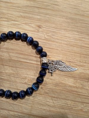 Perlenarmband mit Engelsflügel