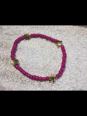 Armdecoratie roze-goud